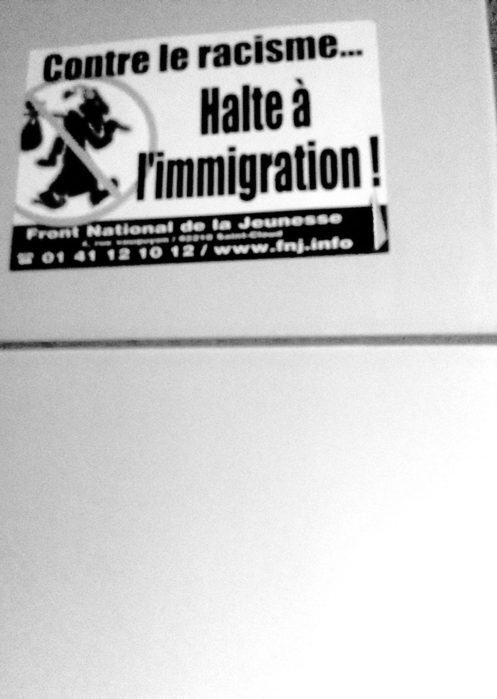 A polite anti-immigrant poster that is careful to note that the poster may look racist but it is not.