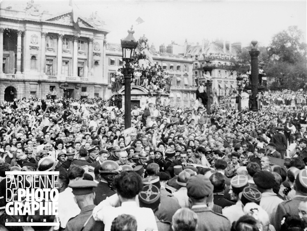 Here, in a liberated city, Parisians gather to listen to Gen. Charles de Gaulle. Source:LAPI/Roger Viollet